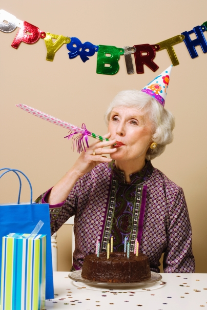 Senior woman celebrating birthday, indoors